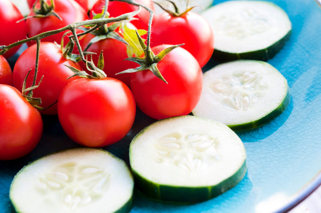 Fresh cherry tomato on the daylight. Selective focus on the tomato