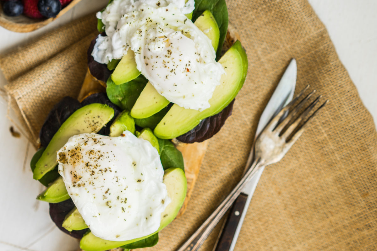 sandwich with avocado and poached eggs