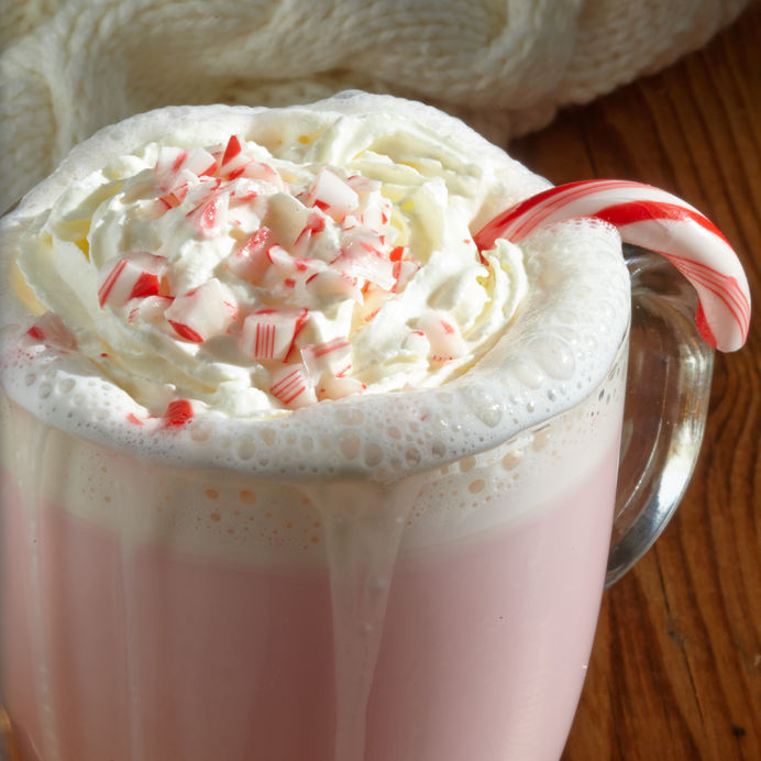 peppermint hot white chocolate with candies and whipped cream