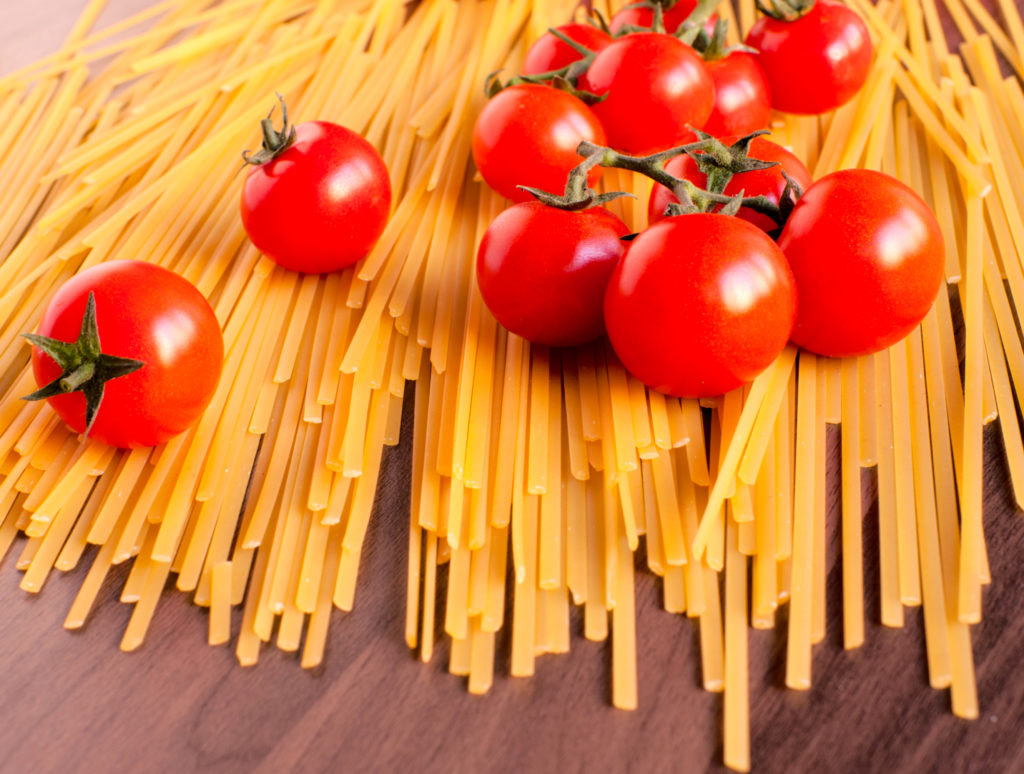 Raw spaghetti and cherry tomatoes