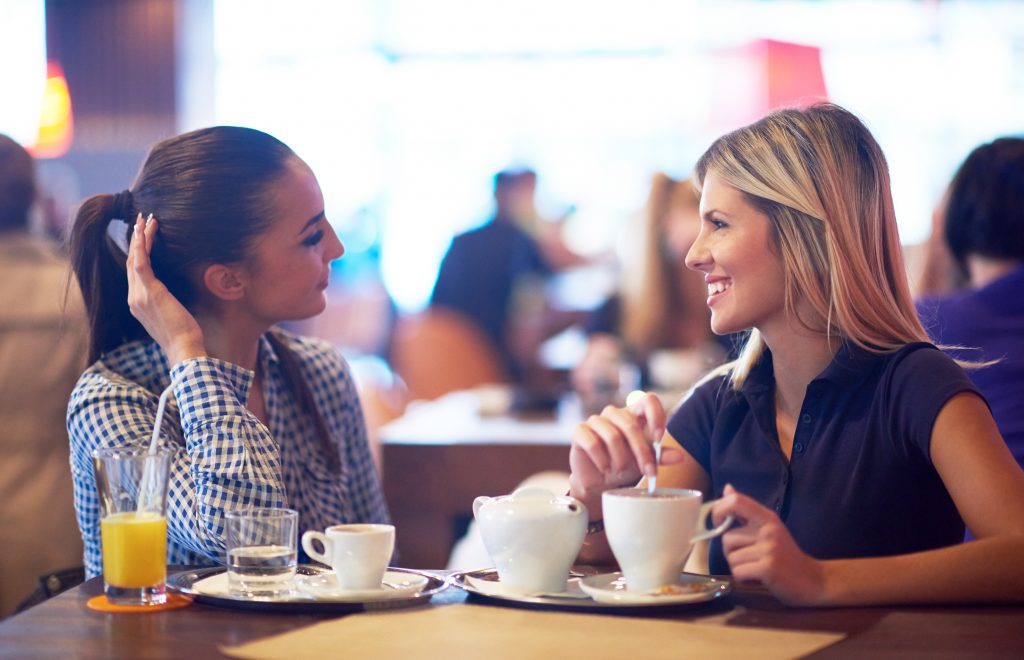 Friends enjoying cups of coffee