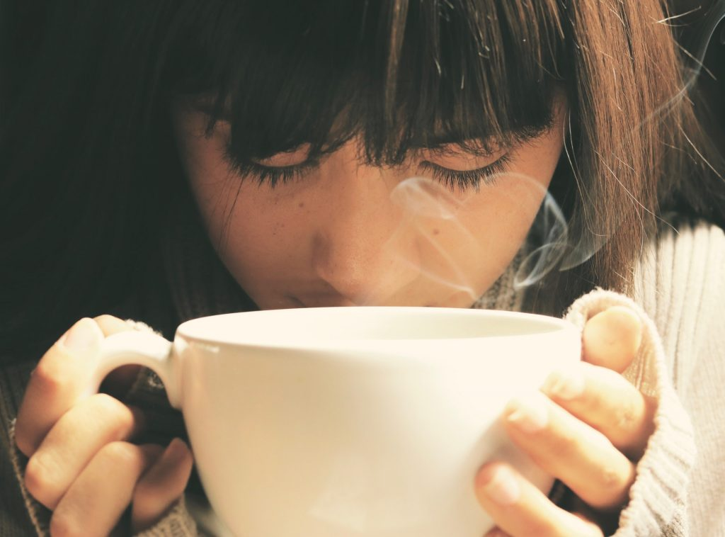 Steamy cup of coffee in a gourmet coffee shop