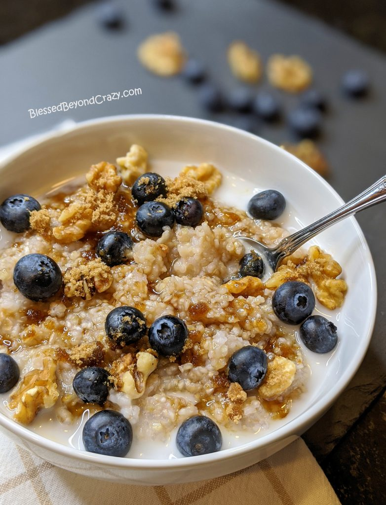 Close up of buckwheat porridge with walnuts, blueberries and brown sugar