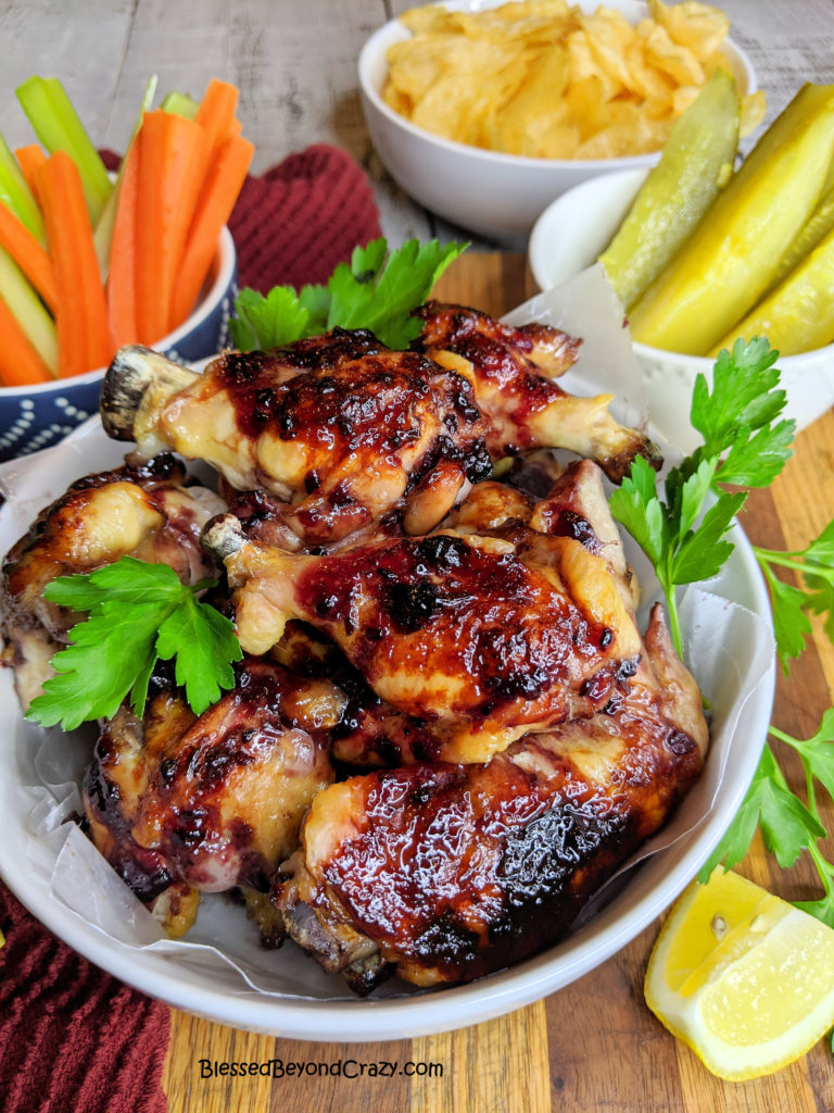 Bowl of delicious Baked Sticky Blackberry Chicken Wings