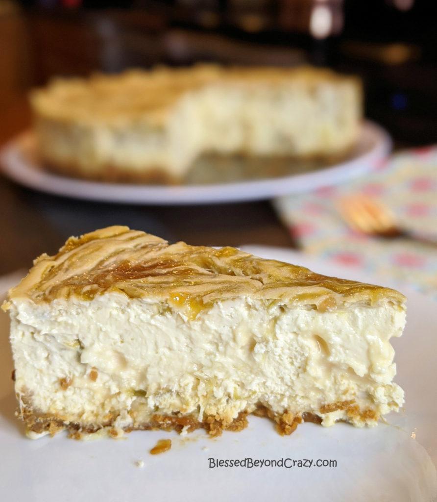 Close up view of slice of Rhubarb Swirl Cheesecake