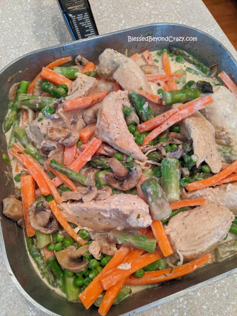 Sauce cooking in Easy Gluten-Free Skillet Chicken Primavera
