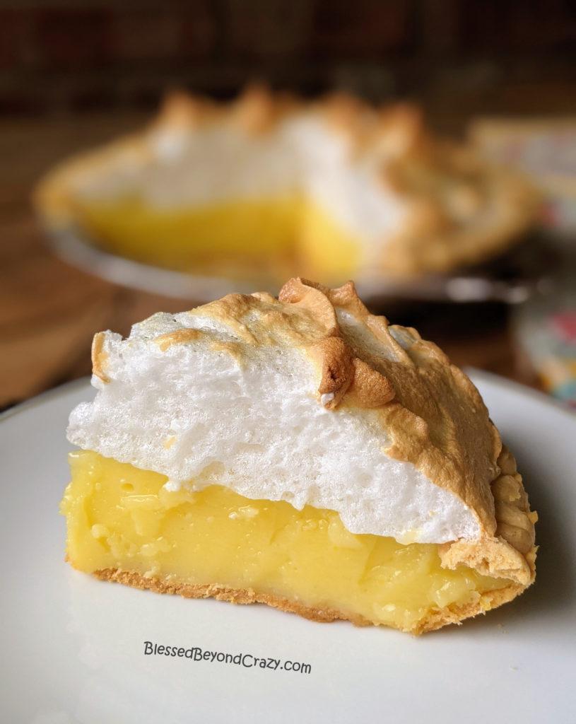 Close up view of a slice of Easy Lemon Meringue Pie (Gluten-Free Option)