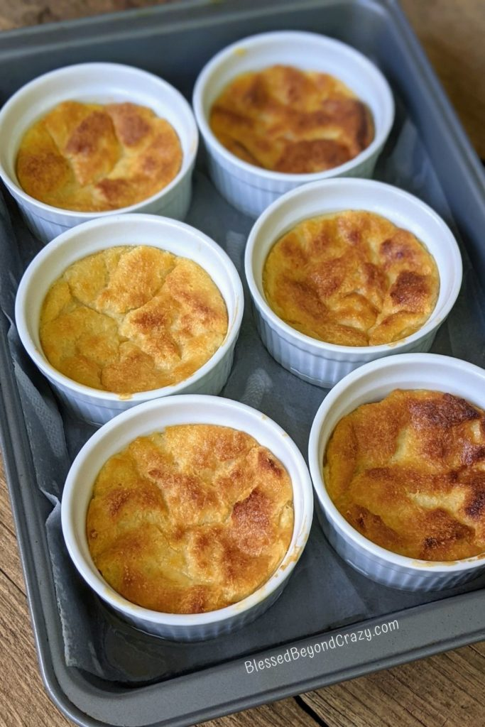 Six ramekins of Lemon Bread Pudding straight out of the oven.