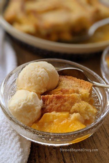 Ice cream served alongside serving of peach cobbler